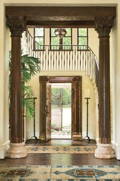 A dramatic, double-height entryway perfectly captures the Mediterranean style of this Texas home. The standing candelabra is by Jan Barboglio, pieces from Esmaili Rugs and Antiques complete the space. Tour the entire home   - TownandCountryMag.com