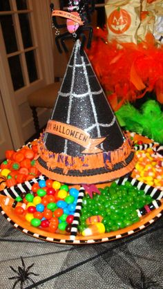Awesome Halloween party idea, pop a witches hat on your candy divider dish…