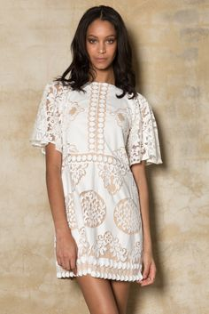 Reinterpreting romance, Bruna is the modern mini dress capturing the spirit of the woman on the go. Versatile & luxurious this semi-fitted shift dress features a magnificent bold-patterned white embroidery throughout the entire garment and raglan sleeve. The Bruna is the ideal style for a fun, flirty & effortless look encapsulating 70s chic with the …
