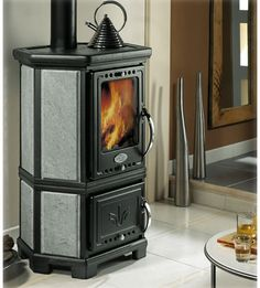 Tiffany Decorata The Tiffany Decorata has large grate door for better flame view and easier wood loading. This wood burning stove also features a new [. Small Wood Burning Stove, Stove Heater, New Stove, Cooking Stove, Wood Tile Floors, Stove Fireplace, Wood Burner, Cabins And Cottages, Tiny Spaces