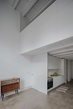 Pedro Ferreira converts abandoned Porto house into flats with pine and marble surfaces
