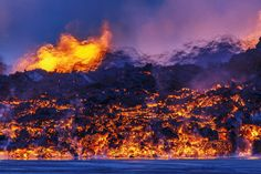 Iceland's Bardarbunga volcano, which has been erupting since Aug. 29 - A close-up night view of the lava flow as heat from the lava distorts the view of the fountains in the distance on Sept. 2, 2014.