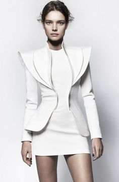 White Suit with sharp, sculptural lines; structured tailoring