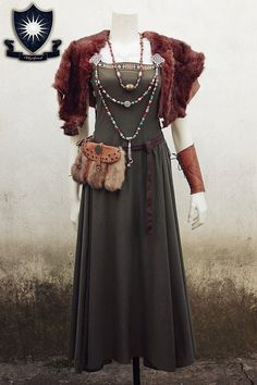 This dress is unique and was inspired in the Viking Smokkr dresses of the viking women. Its perfect for any viking enthusiastic.  Dress is made of