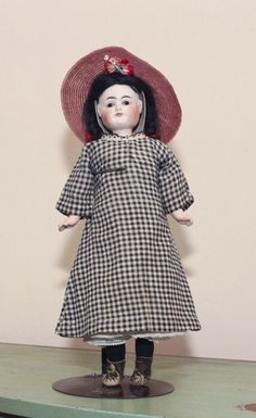 German Combination Black & White antique doll circa 1900 by Carl Bergner from Kathy Lybraty's antique doll collection on display at her home in New York.  By turning the face you get either a black child or a white child, which has been valued at £1,600.