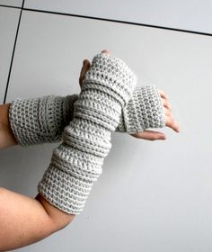 Crochet pattern, Instant Download long fingerless gloves, wrist warmer crochet pattern, fingerless glove pattern (251) A perfect long fingerless gloves to wear with sweaters or three quarter sleeve jacket/coats. They are fast to make and a great to wear all seasons. Size: The pattern is written for Medium size with changes for Small and Large. Materials and Notions: Drops Nepal in grey mix, for the smaller size you will need approx. 130g (195m, 213 yards), medium size 150g (225m, 246 ...