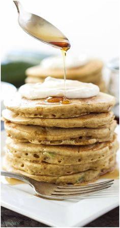 Zucchini Bread Pancakes with Maple Cream Cheese Topping - Whole wheat, tender, fluffy, zucchini loaded pancakes not only taste delicious, but are good for you as well! Top them with the maple cream cheese topping for a decadent and delicious breakfast!