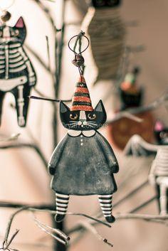 Witch Cat Halloween Clay Folk Art Ornament. $11.50, via Etsy.