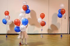 A little girl plays with balloons at Republican U.S. Senate candidate Scott Brown's midterm election night rally in Manchester, New Hampshire November 4, 2014.