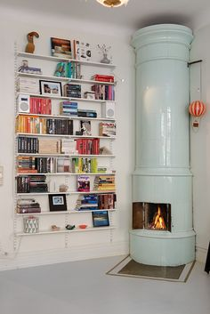 Cool wall-shelving and pretty fireplace