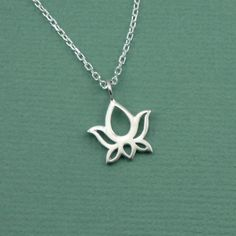 Tiny Lotus Necklace - sterling silver yoga flower charm jewelry - zen gift. $29.00, via Etsy.