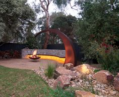 Shoreham Project. Suspended fire pit and cantilevered bench seat with LED lighting.
