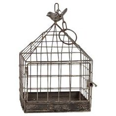 """Accent a dining table centerpiece with this vintaged metal birdcage decor, or use it to display a favorite pillar candle in an unexpected fashion.   Product: Birdcage decorConstruction Material: MetalColor: GrayAccommodates: 13"""" H x 8.86"""" W x 8.86"""" D"""
