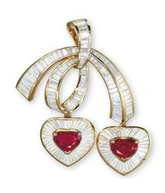 A gold, ruby and diamond pendant/brooch in the form of two love hearts suspended from a bow. (Christie's)