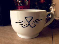 Drawing with Sharpie on mugs then baking them for the marker to stay... interesting!