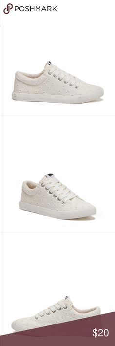 Textured sneakers White brand new never worn before. They are good with alot of outfits, during all seasons. Price is negotiable. Rocket Dog Shoes Sneakers