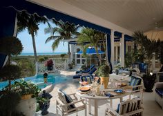 Giatti teak chairs and chaises, and Lloyd/Flanders casual wicker furnishings comprise the seating in this loggia. An infinity-edge pool and Jacuzzi provide the perfect spot for soaking in the view.