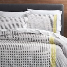 Shop Torben Yellow Twin Duvet Cover.  Loving the immediacy and irregularity of hand-drawn designs, Genevieve Bennett has created a stunning motif of fine lines and playful dots just for us in a fresh palette of grey and yellow on white cotton.