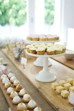 a spread of mini desserts and tea sandwiches - wooden planks for height down center of table. Buffet Dessert, Dessert Bars, Dessert Tables, Food Tables, Mini Desserts, Easy Desserts, Italian Desserts, Simply Seleta, Comida Para Baby Shower