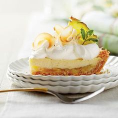 Piña Colada Icebox Pie | Forget the rolling pin and tricked-out lattice topping—just pat the crust in the pan, add a little tropical flair (we're talking a delicious pineapple-coconut filling here), then bake and chill. | SouthernLiving.com