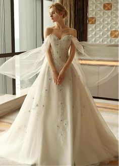 Alluring Tulle Off-the-shoulder Neckline A-line Wedding Dress With Sequin Lace Appliques & Beadings