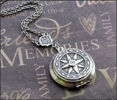 Compass locket necklace.
