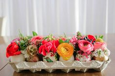 Simply beautiful - held in egg cups to double as wedding favours