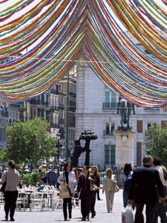 Google Image Result for http://imgc.allpostersimages.com/images/P-473-488-90/21/2149/XQ1CD00Z/posters/jeremy-bright-pedestrian-street-with-decorations-puerta-del-sol-madrid-spain.jpg