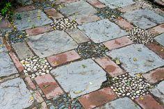 Malaga, Spain Brick and river rock patio Small Backyard Gardens, Backyard Landscaping, Outdoor Gardens, Large Backyard, Garden Yard Ideas, Garden Paths, Patio Ideas, River Rock Patio, River Rocks