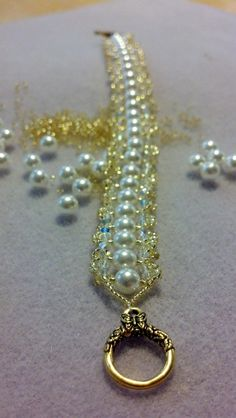 This is a Misti's Jewelry Original called Pearls & Lace.  It's made with genuine Swarovski crystals & Pearls with a gold-plated toggle clasp.  www.mistisjewelry.com/shopping.html