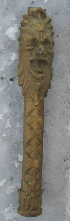 """This is old cast iron, 19"""" long, and vintage Cast Iron Garden Architectural salvage item......maybe off of a Fireplace Hearth or fancy wooden front door. Figure of North Wind or old man of the north."""