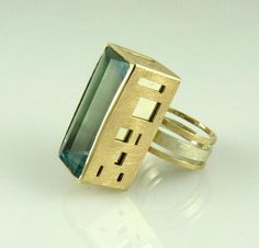 Niamh Spain Jewelry  - Inspired by her love for contemporary architecture, she made this ring for the RDS National Crafts Competition 2012. It's made from a large emerald cut aquamarine set in a 9ct yellow and white gold ring.