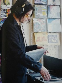 Jack white listening to some vinyl