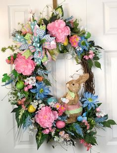 Easter bunny wreath, floral wreath, floral spring wreath, Easter floral wreath, Easter egg wreath, easter door wreath, spring porch wreath by KeutherCrafts on Etsy https://www.etsy.com/listing/579882410/easter-bunny-wreath-floral-wreath-floral