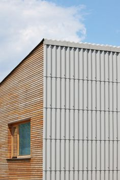 Corrugated fiber-cement panels wrap the roof and wall. Single-family House in Groharjevo / Wooden Facade, Metal Facade, Architecture Details, Interior Architecture, Facade Design, House Design, Garden Office, Cladding, Home And Family