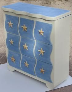 cardboard cabinet with nautical theme