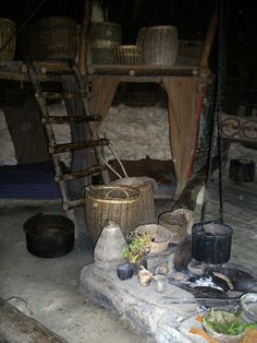 Recreation of British Celtic Round House. There is evidence of a saddle quern-stone, which would have been used to grind corn* to make bread. There may have been an oven somewhere in the roundhouse (pictured - right)*.