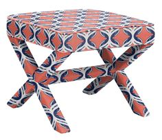 Tolstoy Ottoman in Crossed Flower, Grapefruit Deep Blue, designed by Sarah and Ruby Design and featured on Guildery