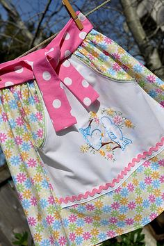 """""""For the first apron, I cut a piece of white fabric for the pocket and used the pattern found HERE to embroidery these cute little birds on the front... So pleased with the way it turned out!"""" Jodi at Pleasant Home used Aunt Dotie's pattern.    Love the embroidery on this adorable apron."""
