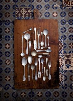 size and shapes of cutlery on plain board of highly patterned background - interesting #bywstudent