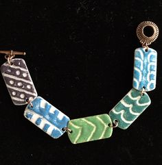 """Torch fired enamel on copper using the """"sgraffito"""" technique."""