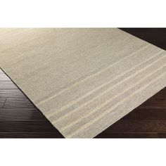 Bring luxury to your home with this casual area rug. Hand-Woven with 20-percent cotton, 10-percent jute, 70-percent wool, this stripe designed rug will add a pop of color and the finishing touch to your decor.