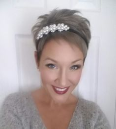 Silver pixie cut using Paul Mitchell Pop XG in Steel, with headband and red lipstick. Holiday ready!