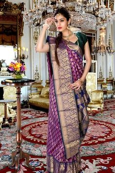 Purple pure silk zari weaved saree in royal blue & gold border  Buy Now @ Rs 7790