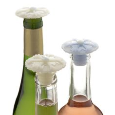 The CHARLES VIANCIN® silicone bottle stopper  is a fun and functional accessory that is perfect for keeping an open bottle's contents fresh.  Simply twist the  bottle stopper  into the neck! An essential accessory for the wine lover and an unique gift for any occasion. Sold in sets of 2 (one comes in light blue and one in white).
