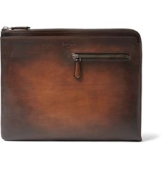Berluti's 'Au Grand Jour' document holder is made from the brand's signature hand-polished Venezia leather, in a rich graduating tobacco hue. This investment in fine Italian craftsmanship is designed to mature with you. It's fitted with nifty slip and zipped pockets that'll keep your stationery and paperwork strategically organised. Use yours to make an impression at the office.