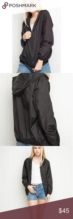 Brandy Melville Scar black windbreaker with hood Excellent condition no flaws Brandy Melville One size Scar windbreaker black shiny fabric. Elastic gathered hem and cuffs 2 hand warming side pockets zip up with hood Brandy Melville Jackets & Coats
