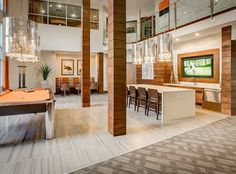 Expansive resident lounge and clubroom with business center at AMLI Riverfront Park, LoDo luxury apartments.