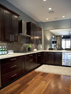 espresso cabinets, gray back splash, and blue/gray wall paint