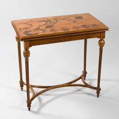 """A French Art Nouveau games table by Emile Gallé, featuring inlaid fruitwood marquetry depicting thistles and card suit symbols. A similar table is pictured in: Gallé Furniture, by Alastair Duncan and Georges de Bartha, Woodbridge, Suffolk: Antique Collectors' Club, 2012, p. 130, plate 1. Artist: Gallé Signed: 'Gallé a Nancy"""""""